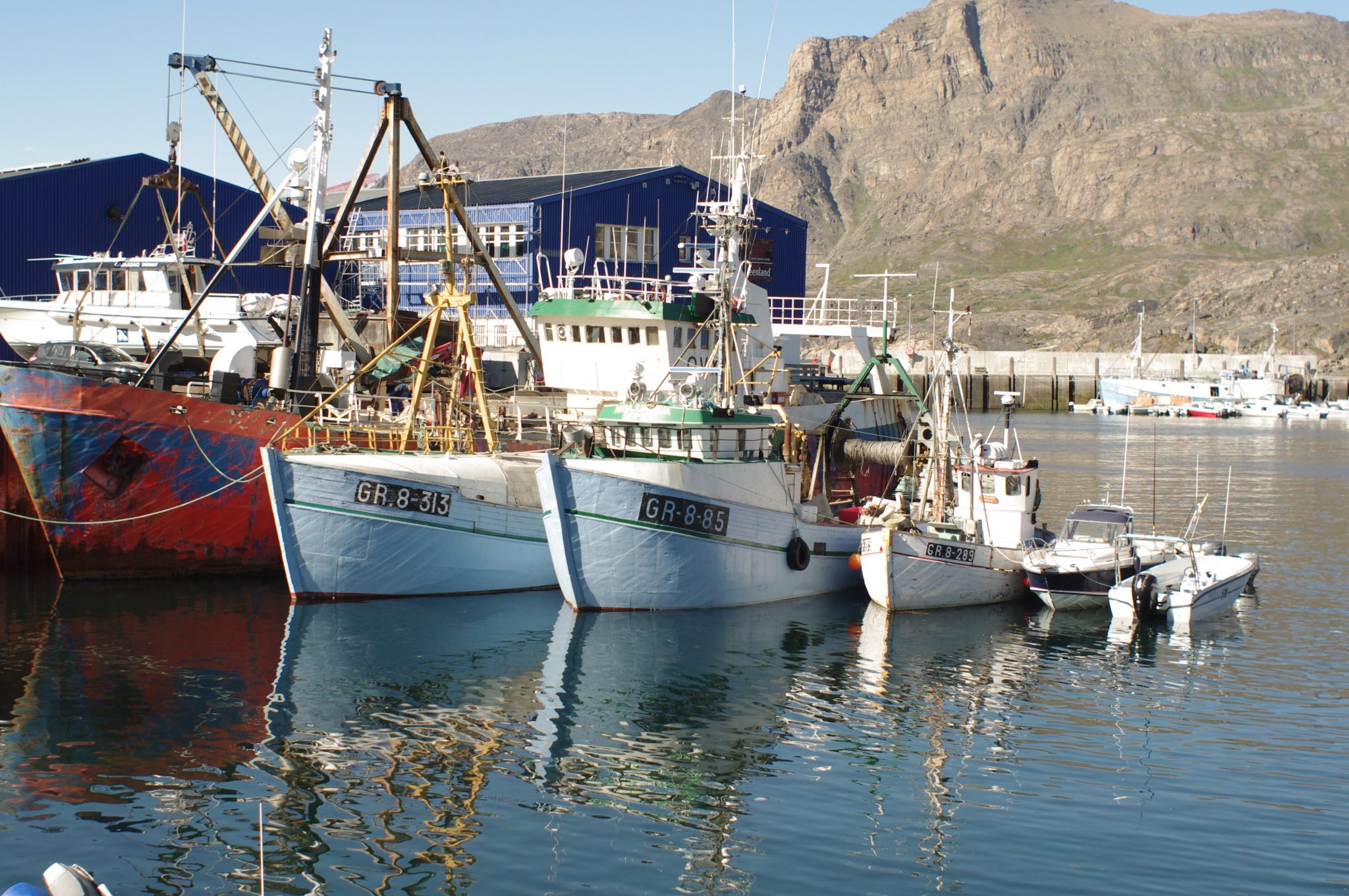 Fishing boats tied up in Sisimiut, Greenland.