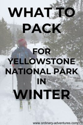 A woman skiing on a trail among trees. She is wearing a red hat and a backpack and looking to the right. Text says What to Pack for Yellowstone National Park in Winter