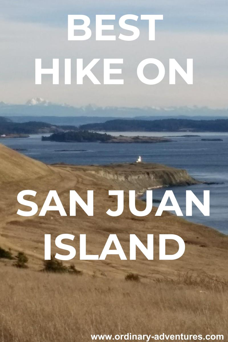 grassy meadow along a shoreline with a lighthouse, islands and mountains. Text reads Best Hike on San Juan Island