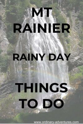 Waterfall over rocks with a rainbow. Text reads: Mt Rainier Rainy Day Things to do