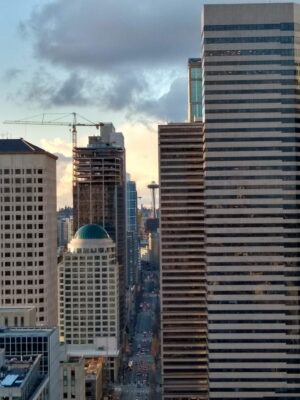 Tall buildings with the Space Needle between them