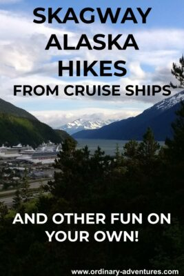 Distant snow capped mountains with a fjord and a small town with several cruise ships in port and evergreen trees in the foreground. text reads: Skagway Alaska Hikes from cruise ships and other fun on your own