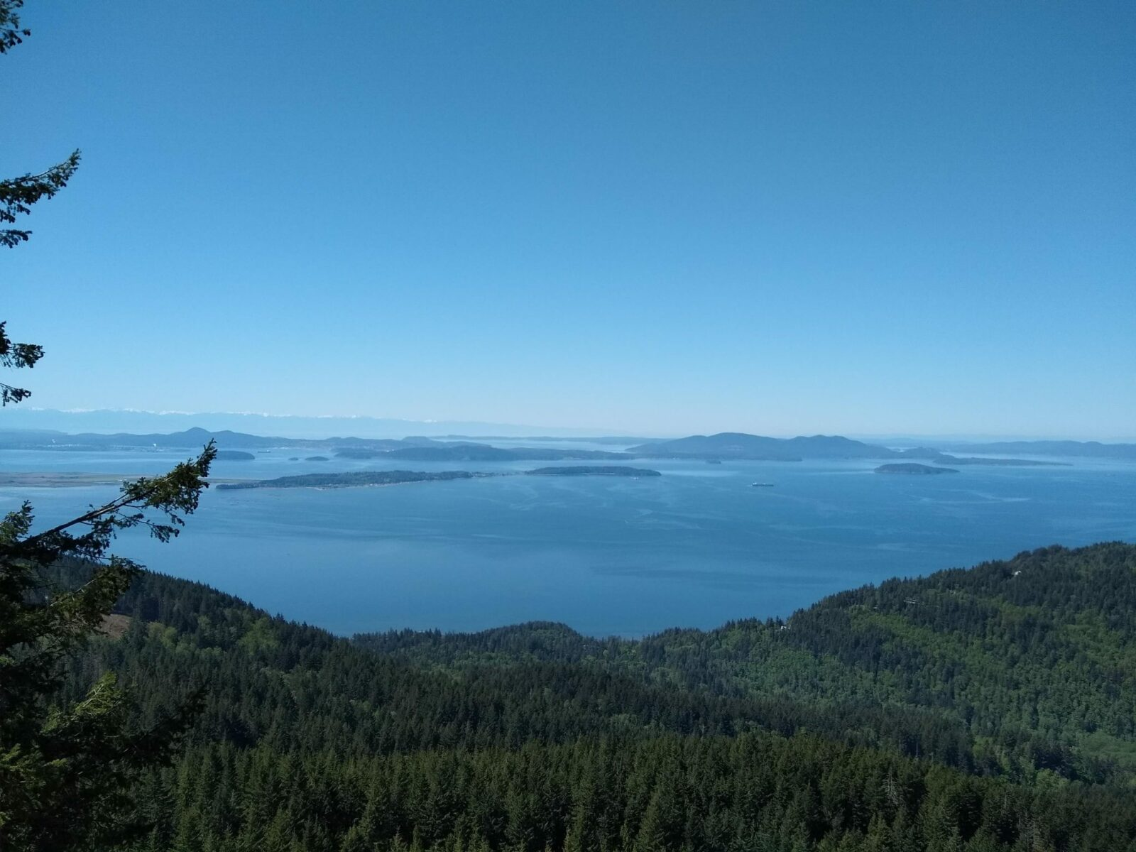 A view from a high place over water and distance islands on a sunny day