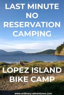 Lopez Island bike camping at Spencer Spit State Park. There is a grassy spit in the foreground wtih a canoe, tideflats and water behind. Forested islands are in the background on a sunny day. Text reads: Last minute no reservation camping, Lopez Island bike camp