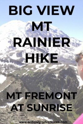 Mt Rainier, a high, snowcapped mountain on a clear day. The side of a woman's face is visible on the side. She is wearing a hat and sunglasses and looking at the mountain. Text reads: Big view Mt Rainier hike, Mt Fremont at Sunrise