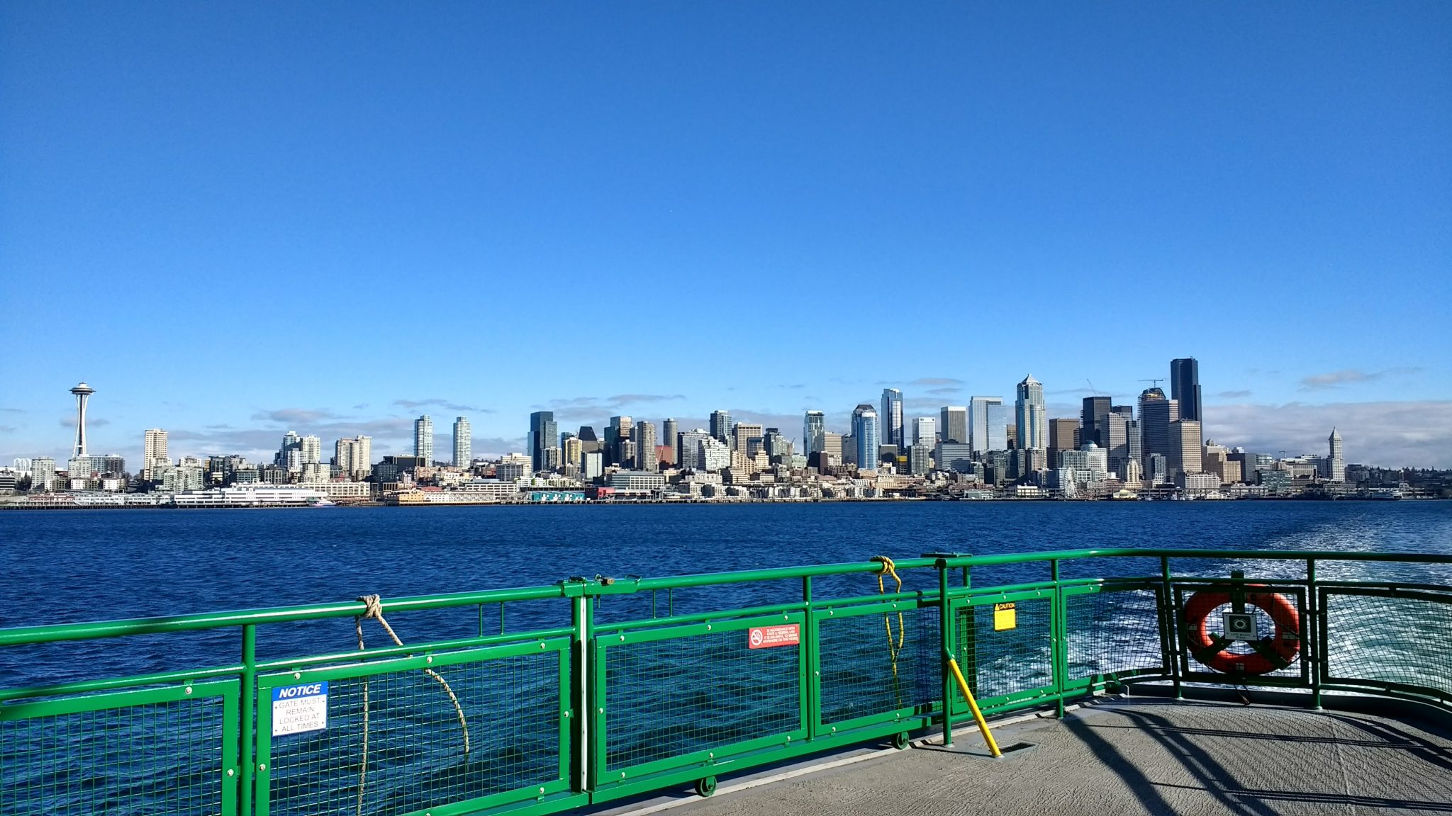 The Seattle city skyline from the ferry. The deck of the ferry is in the foreground