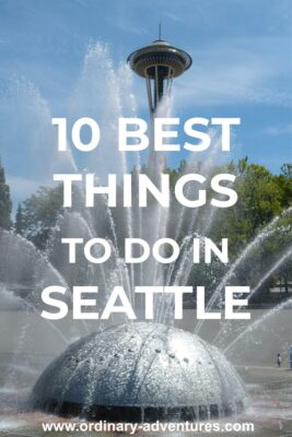 A fountain is spraying in front of green trees and the Space Needle. Text reads: 10 best things to do in seattle