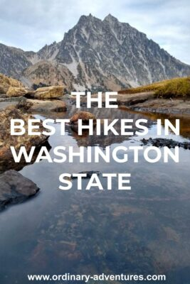 A high mountain rises above a pond on the Lake Ingalls trail. Text reads: The best hikes in washington state