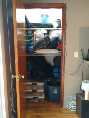 Part of camping checklist is keeping the gear organized. This is a gear closet with places for all the camping gear