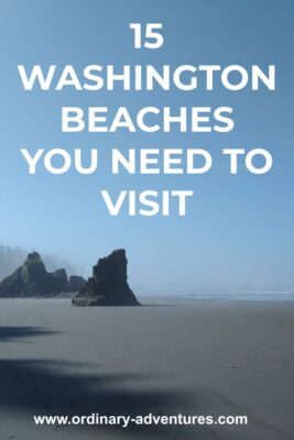 A smooth sandy beach around big rocks on a sunny day with some low fog. Text reads: 15 Washington beaches you need to visit