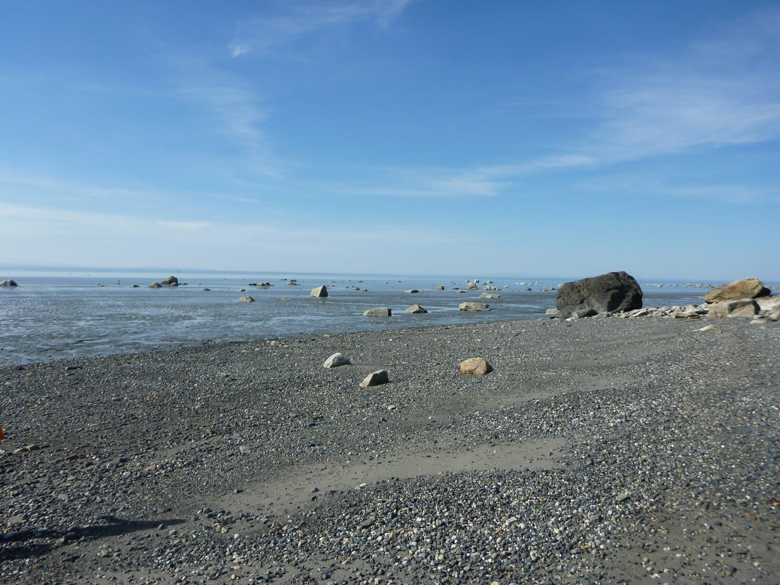 Camping in Alaska at the Captain Cook Campground has a gravel beach on a large body of ocean water