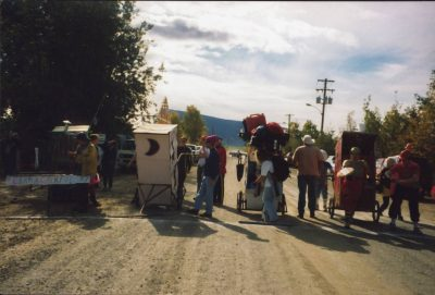 A quirky thing to do in Dawson City is the annual outhouse race. Here four outhouses decorated and on wheels line up at the start on a gravel street in town