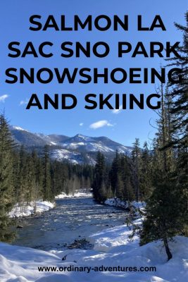 Forested and snowy distant low mountains with an evergreen forest and snow around a river. Text reads: Salmon la sac sno park snowshoeing and skiing