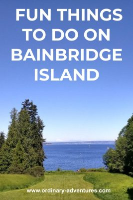 Blue water with sailboats in the distance and several trees and a green lawn in the foreground. Text reads: fun things to do on bainbridge island