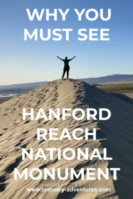 A person standing on top of a sand dune in late afternoon sun. Their hands are in the air looking at the view. Text reads: Why you must see hanford reach national monument